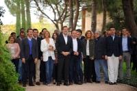 Cospedal y Rajoy, junto a la plana mayor del PP, en Toledo.